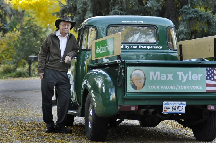 Max Tyler, candidate for House District 23, poses with his campaign truck at his home in Lakewood.