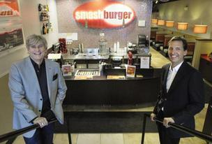 Smashburger founder Tom Ryan and CEO/President David Prokupek, at the downtown Denver restaurant in the Tabor Center