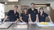 Everett McEwan, videographer and editor; Tammie Waddell, marketing manager; Tom McDonald, director of production and partner; and Naomi Binkley, founder, manager and partner, all from Fireside Production, serve breakfast at Urban Peak. It is just one of the nonprofits the company supports.