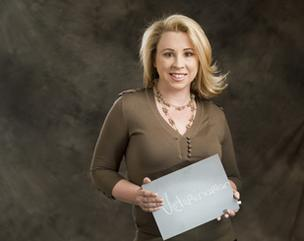 The Denver Business Journal's Forty under 40 winners were asked when they were in kindergarten, what did they want to be when they grew up? At the photo shoot they wrote their answer on the blackboard.  Michelle McCollum wanted to be a veterinarian.