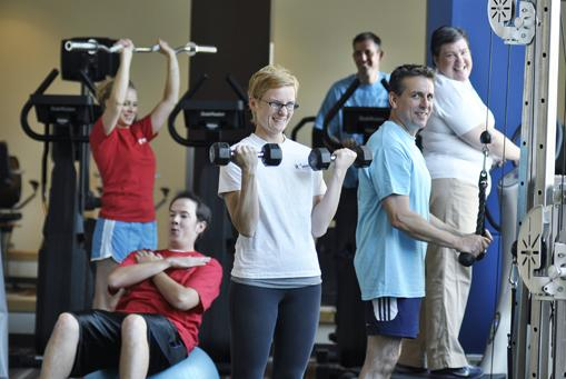 Wilson & Company Inc. employees work out at Forza Fitness & Perfomance Club where they get a discounted corporate rate. Left to right, Shelby Bosko, marketing coordinator; Kyle Godwin, design engineer, on at fitball; Marlo Grabsztul, administrative manager; Jim Brady, senior vice president, on a stair climber; Todd Riddle, creative director; and Betsy Ackerman, administrative assistant.