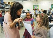 Jenny Tennant, a second-grade teacher at STEM Magnet Lab School, works with students Abrianna Cordova and Makayla Clemons. The Adams 12 Five Star School District program serves grades K-8.