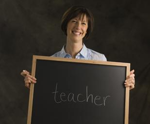 The Denver Business Journal's Forty under 40 winners were asked when they were in kindergarten, what did they want to be when they grew up? At the photo shoot they wrote their answer on the blackboard.  Alison Wadle wanted to be a teacher.