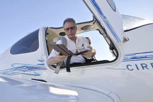 Bob Stedman, certified flight instructor and owner of Independence Aviation at Centennial Airport, uses the MyGoFlight kneeboard to pull up flight maps on his iPad. The kneeboard makes it easier for pilots to read the maps.