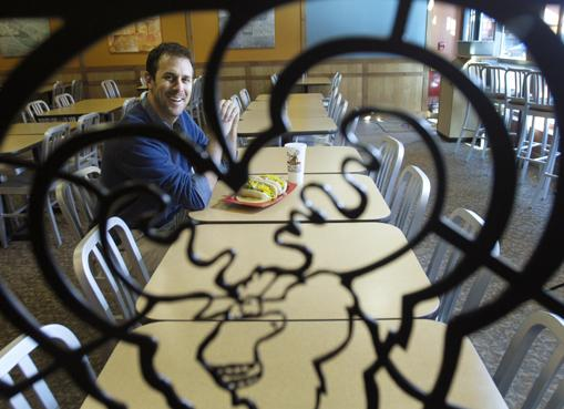 Larry Hill, director of development for Smiling Moose Deli, enjoys lunch at the 1515 Wynkoop location. Hill has been with the Boulder-based company promoting franchises since 2008.
