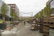 """Palettes of brick await placement along the Fillmore Plaza area. The pattern of the bricks is intended to evoke the image of carpet rather than just a street, making it feel like one, big outdoor """"room."""""""