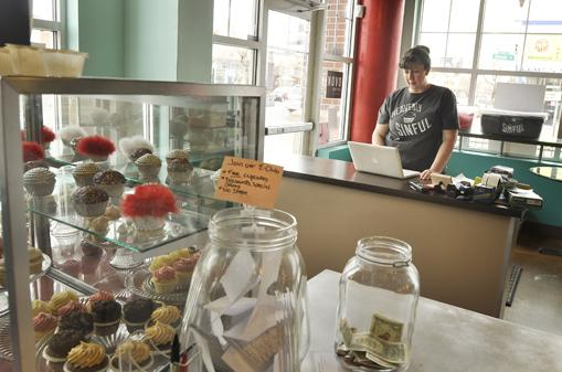 Porche Lovely, owner of Church of Cupcakes, uses social media to promote her cupcake business on Colfax Avenue and Steele Street. She makes sure to check it throughout the day to make sure she responds to tweets and text messages.