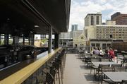 """The Tavern Downtown, part of the Tavern Hospitality Group, remodeled its rooftop deck last year. It has been awarded """"Sports Bar of the Year 2011"""" by Nightclub and Bar magazine."""