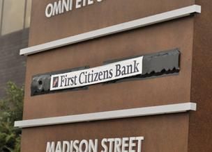 The nameplate for failed Colorado Capital Bank in Cherry Creek is covered with black tape, then labeled with a sticker for First Citizens Bank, which recently purchased the assets.