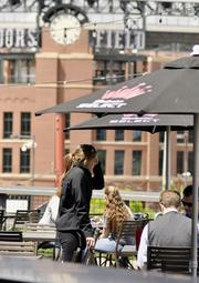 Tavern Downtown's rooftop patio overlooks Coors Field. On game days, hundreds of people make it their pregame stop.