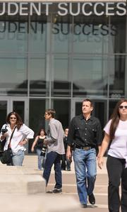 Matt Wardlow, environmental division manager at CTL Thompson (in the black shirt), walks in front of the new Student Success Building on the Metropolitan State University of Denver campus. In excavating the land prior to construction, engineers found things from 1940s phone books and cannon balls, to tunnels built for transporting beer.