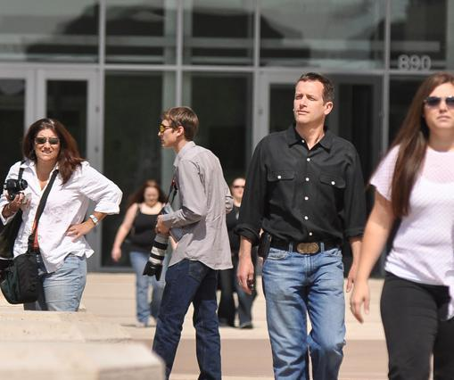 People walk in front of a Metropolitan State University's Student Success Building, which opened this spring as part of the Auraria campus in downtown Denver.