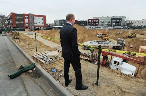 Erik Hagevik, COO and partner at Holland Partners, looks over the development site of a project, temporarily called Highland Bridge Lofts, near 16th and Boulder streets. It will be a five-story, mixed-use development with 130 apartments in the lower Highlands neighborhood.