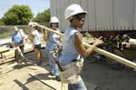 Women join forces to build Habitat for Humanity project