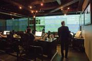 Kurt Hall, chairman and CEO of National CineMedia, watches production in the networks operation center.