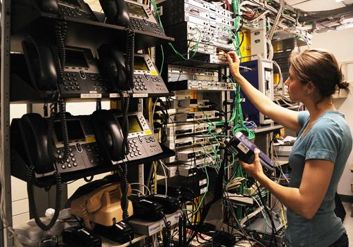 Sarah Zaepfel, employee of TW Telecom, tests and verifies network infrastructure, circuits and VoIP.