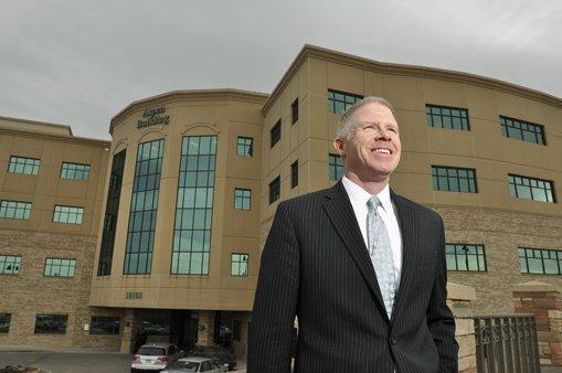 Daniel Burke, CBRE's vice president and head of the medical market for Denver, stands outside the Aspen Building at Sky Ridge Hospital.