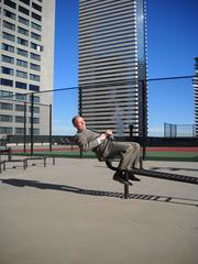 Grand Hyatt Downtown General Manager Greg Leonard gets in some crunches in on the new circuit equipment at the hotel's new rooftop track.