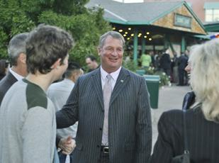 Arrow Electronics CEO Mike Long talks to employees and their families at a party at the Denver Zoo Oct. 11.