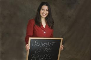 The Denver Business Journal's Forty under 40 winners were asked when they were in kindergarten, what did they want to be when they grew up? At the photo shoot they wrote their answer on the blackboard.  Crisanta Duran wanted to be a servant of the people.