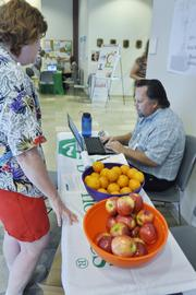 Patrick Jenkins, environmental health and safety manager at Quest Diagnostics, looks up health information for an employee at a wellness event.