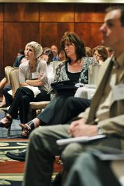 Michele Worthington, far left, listens during the Health Care Reform event.