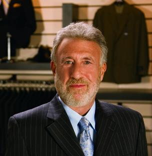 "The Men's Wearhouse Inc. co-founder George Zimmer told analysts Thursday about the company's successful new ad campaign: ""It's simple. Me,  driving around downtown, passing a lot of young, hip, and even tattooed  customers promoting modern fit clothing."""