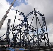 This photo shows some of the loop inversions on the Iron Shark rollercoaster during construction in April. A second sub-floor deck was placed along the entire length of the pier to help anchor the bigger rides being installed.