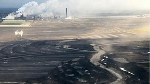 A report by CBC News says the Canadian government has warned that rising costs may affect future oil sands production.