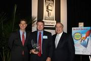 Greg Bloh, center, president, Secure Cash Network accepts his company's award from Dave Kerr, left, manager, business banking, Whitney National Bank, and Antonio Grijalva, CEO and co-founder, G&A Partners Inc. KIM COFFMAN