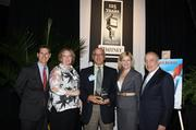Elaine Robichaud; Bob Eisenshtat, president; and Melissa Edenfield of Standing Ovations accept their company's award from Dave Kerr, left, manager, business banking, Whitney National Bank, and Antonio Grijalva, CEO and co-founder, G&A Partners Inc. KIM COFFMAN