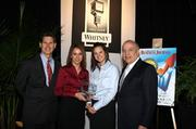 Kilgore Industries: Marissa Guerra and Nikki Frank of Kilgore Industries, accept their company's award from Dave Kerr, left, manager, business banking, Whitney National Bank, and Antonio Grijalva, CEO and co-founder, G&A Partners Inc. KIM COFFMAN