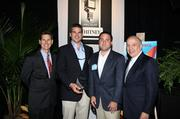 Lee Zieben and John Kirskey Jr., co-owners of ZK Homes, accept their company's award from Dave Kerr, left, manager, business banking, Whitney National Bank, and Antonio Grijalva, CEO and co-founder, G&A Partners Inc. KIM COFFMAN