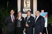 Rachel Malone, contracts manager, and Kenn Hall, vice president of Anadarko Industries LLC accept their company's award from Dave Kerr, left, manager, business banking, Whitney National Bank, and Antonio Grijalva, CEO and co-founder, G&A Partners Inc. KIM COFFMAN