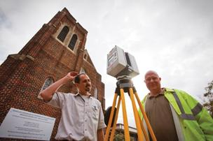 Richard Lasater (left) and Douglas Smith of  Smart MultiMedia: Testing HD scanning technology on Immanuel Luthern Church in the Heights.