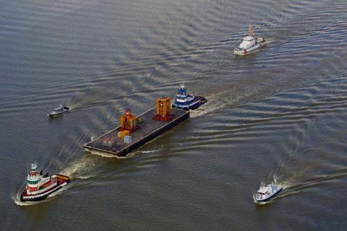 The blowout preventer from the Deepwater Horizon heads up the Mississippi River in route to a NASA facility in Michoud, La. on Sept. 11, 2010 after offloading from the Helix Q4000 in South Pass, La.