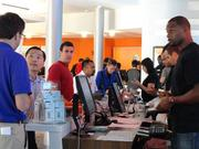 Customers finish their purchase of the new iPhone at the AT&T Experience Store in Houston. AT&T provided a customer service person for each guest.