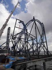 The frame being erected for the Iron Shark roller coaster. Each vehicle seats eight riders who will experience 90-foot vertical lifts, multiple inverted loops and other thrills and chills along the 1,246-foot track in a ride that lasts one minute — with a top speed of 52 mph.
