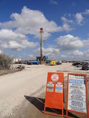 A drilling rig towers against the South Texas sky In Kenedy. It typically takes two days to install a rig.