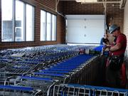 Workers prepare on Oct. 25 for the opening day at Kroger's newest location at 1440 Studemont.