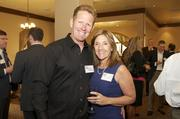 From left: Steve Simmons with Amy Simmons, CEO and president of Austin-based Amy's Ice Creams. Amy spoke about the struggles and rewards of entrepreneurship at the event.