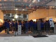 A group of Apple employees gathered inside before the crowd entered.