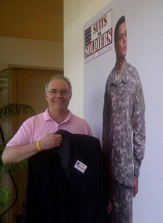 Houston Business Journal Managing Editor Greg Barr with his used suit at the Norton Ditto store on West Alabama. The store is collecting used suits to donate to returning military veterans re-entering the job market.