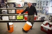 Inside Igloo's showroom, CEO Gary Kiedaisch shows off the company's new wheeled, hard-sided cooler, which also uses technology that prevents liquids from spilling when it is tipped.