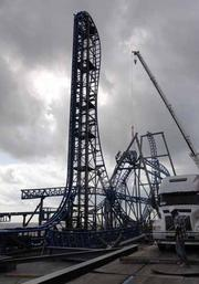 This photo shows the 100-foot vertical drop portion of the Iron Shark during construction in April.