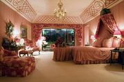 Pretty in Pink: The home's master bedroom is one of six bedrooms in the Lanier home.