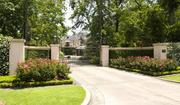 The entrance to the Lanier home is a neo-classical style gate. The home covers nearly 14,000 square feet of space on a lot that is nearly one acre in size.