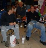 Matt Bonasera, left, and Larry Hack, both of Blinds.com, waiting in line for their iPhone at Memorial City Mall.
