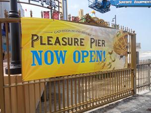 Workers erected a new sign Friday at the entrance to the Galveston Pleasure Pier shortly after 10 a.m. when the doors opened to the public. Click on this image to launch a slideshow of photos from the pier's first day of operation.