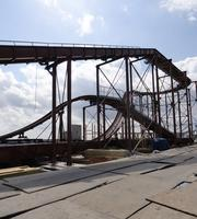 The Pirate's Plunge log flume ride shown under construction. The ride — which will be decked out in a pirate themed facade — will have seven boats, each containing five riders, and two steep drops — one of 40 feet and one of 22 feet. As is the case with several other rides, the track at one point extends slightly over the edge of the pier above the Gulf waters.